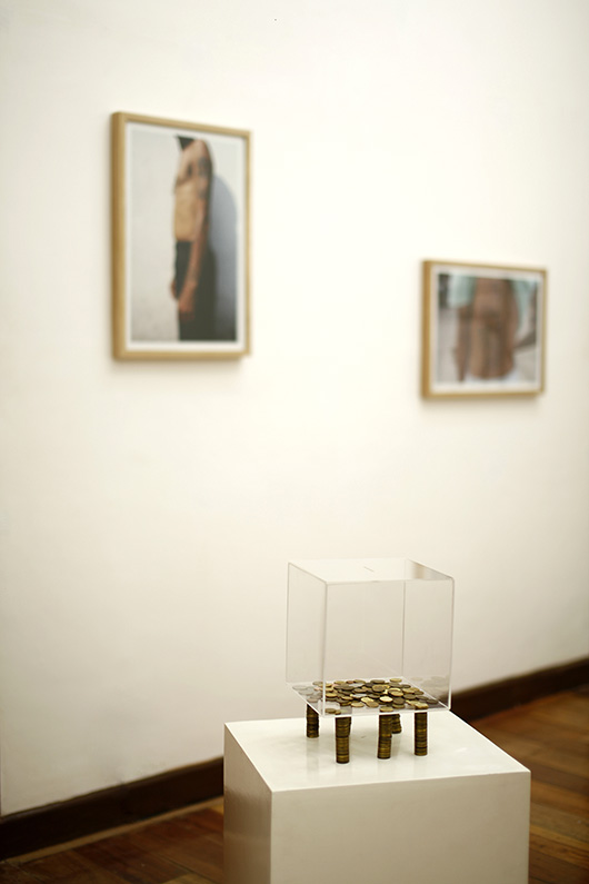 Installation view, artworks by: David Griggs (in the background); Maria Cruz (in the foreground)
