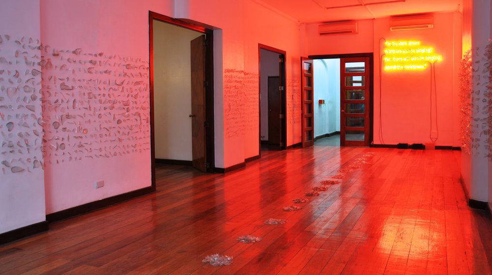 KIRI DALENA  In the dark times, will there also be singing? Yes, there will also be singing. About the dark times, 2017 neon light installation 60.96 x 137.16 cm  White Walls, 2017 glass shards variable dimension  installation view