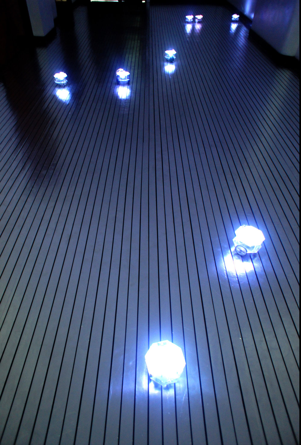 IAN JAUCIAN   Viral Automata 1.0 , 2017 robot swarm on electrified floor variable dimensions   installation view