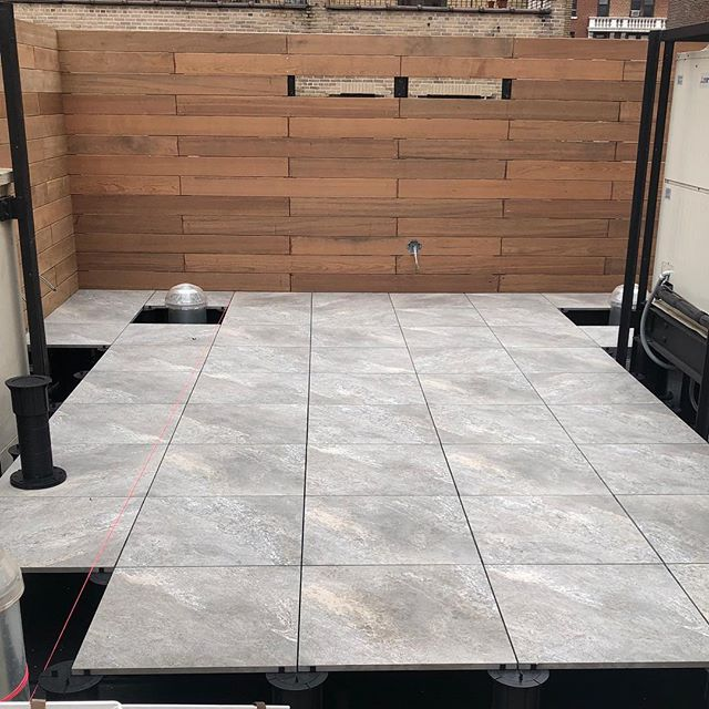 Happy Friday😆working on this rooftop Ipe fence and porcelain deck on pedestals #dioncitylandscapes #dcloutdoorcontracting #landscape #landscapephotography #landscapedesign #woodworking #wood #woodworking #woodwork #deck #deckdesign #porcelain #tiles #tile #rooftop #roof #pedestals #fence #ipe #outdoors #outdoor #outdoordesign #custom