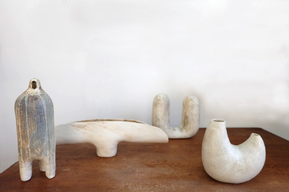 "White stoneware with sand and grog, hand built with slab and coil. Iron oxide.  Fired to cone 6 in an electric kiln. From left to right: Three-Legged Man: 5""W X 5""D X 16""H.  Forest Mushroom: 24"" W X 6"" D X 7""H. Figure With Two Heads: 12"" W X 5.5""D X 11""H.  Body: 9.5""W X 6.5""D X 9.5""H"