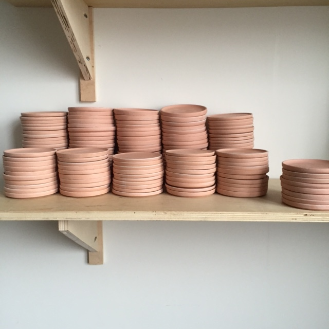 I threw each plate on a wheel.These bisque plates are ready to be glazed and fired for the second time at 2200F.