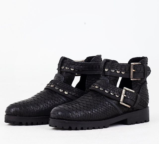 we're proud to introduce our newest designer, DISORDER. shop these python-skin boots and other beauties via link in bio. these boots are made for walking, and for looking dope too. 🖤👩🏽🎤