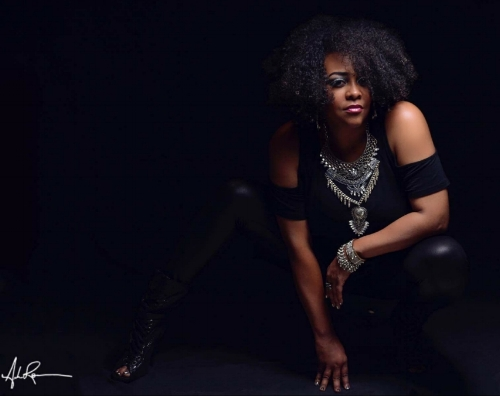 """Who Is The Black Widow? - T's Box Records Artist, Danielle R. Sanders, known musically as Black Widow is a Chicago native, spoken word recording artist, blogger and poet. Her artistry can be heard on house music singles, """"Rough"""", and """"Gruv Me"""" released by Grammy Nominated Producer and CEO of T's Box Records & T's Crates, Terry Hunter under the production of Mike Dunn and Dee Jay Alicia. Both reached #1 on Traxsource's Afrohouse chart in the year of release. She is also featured on the Terry Hunter Retouch of the song,"""