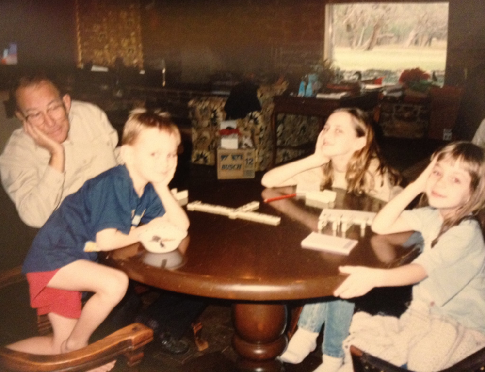 Bob, brother, sister, and I taking a break from a serious dominoes game in 1994.