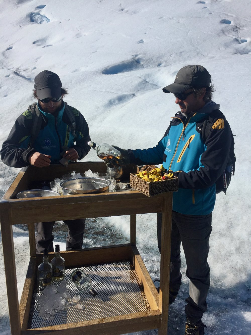 A makeshift bar at the base of a glacier. Salud!