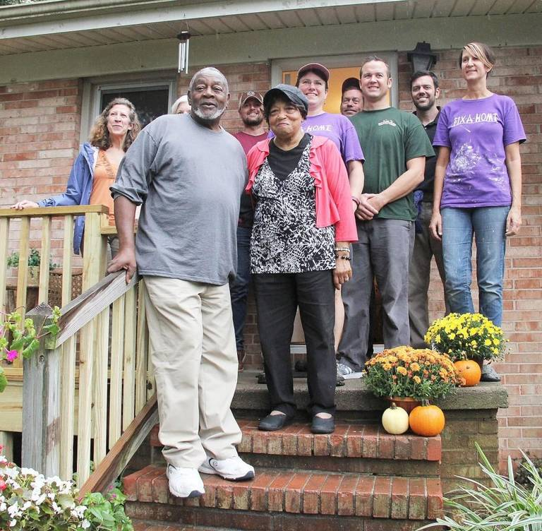 2016 Recipients Paul & Belinda Caldwell with some of the dedicated Volunteers that helped transform their home.