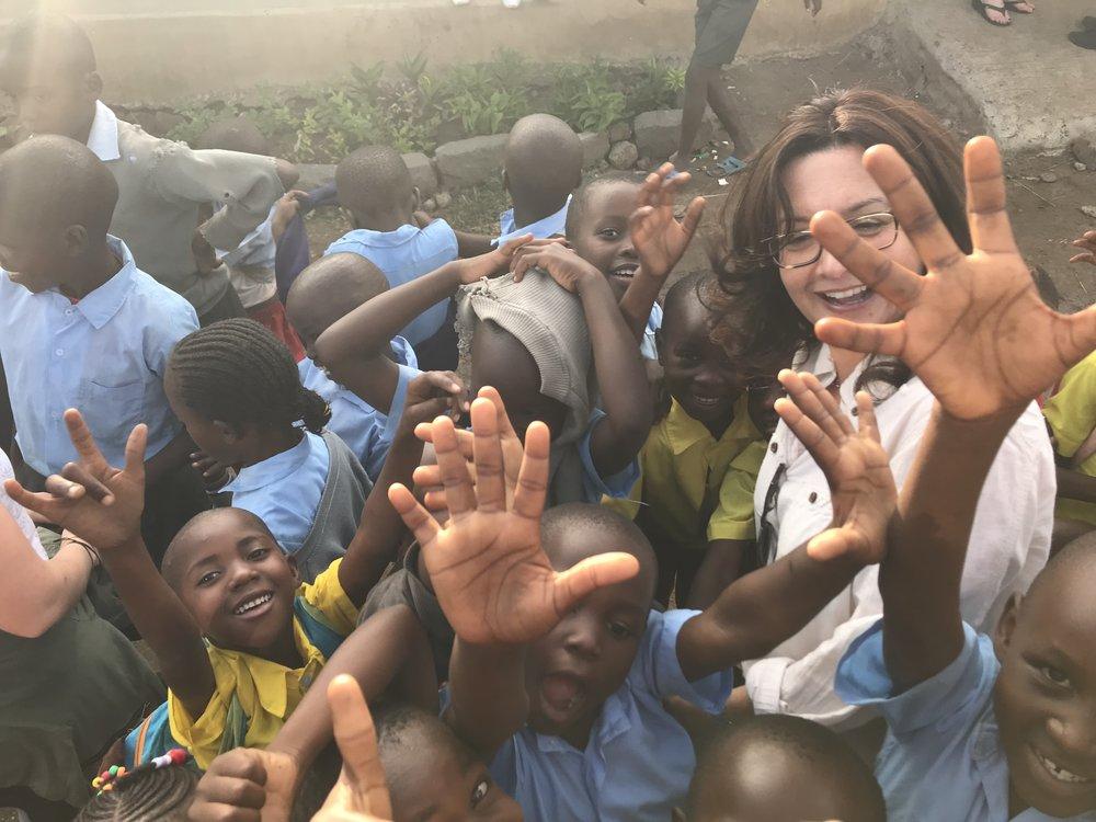 noel children with volunteer.jpg