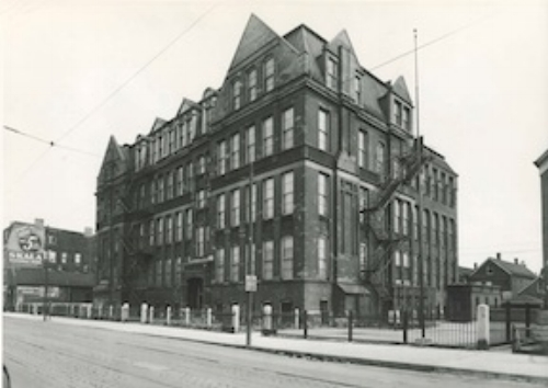 Froebel Elementary, built in 1885, pictured here in 1943. Note the streetcar track and cables. Photo courtesy of the archives at the Chicago Board of Education.
