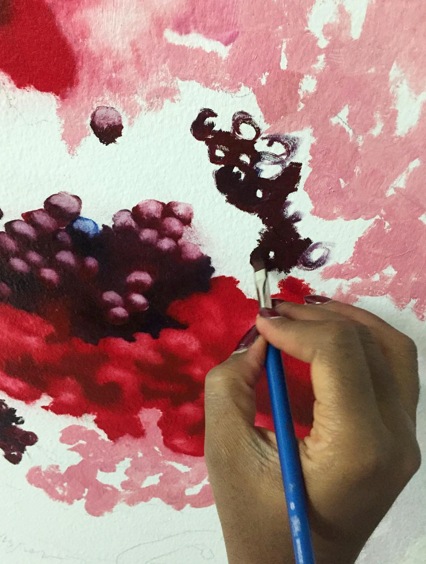 Artist Nengi Omuku working on her wall painting in the Family Room at Eileen Skellern 1 Women's PICU at The Maudsley Hospital