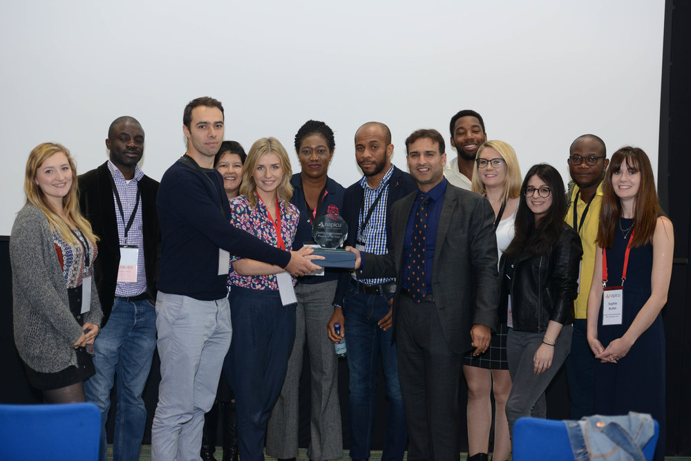 Hospital Rooms' founders Tim A Shaw and Niamh White celebrate winning NAPICU Quality Improvement project of the year with members of the team from Eileen Skellern 1, including consultant psychiatrist Dr Faisil Sethi, ward manager Onyeka Nwankwo, occupational therapist Rebecca Davies, and SPR Dr Sophie Butler.
