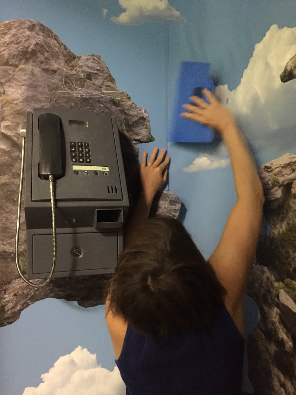Rachael Champion completing the installation of her work in the Telephone Room.