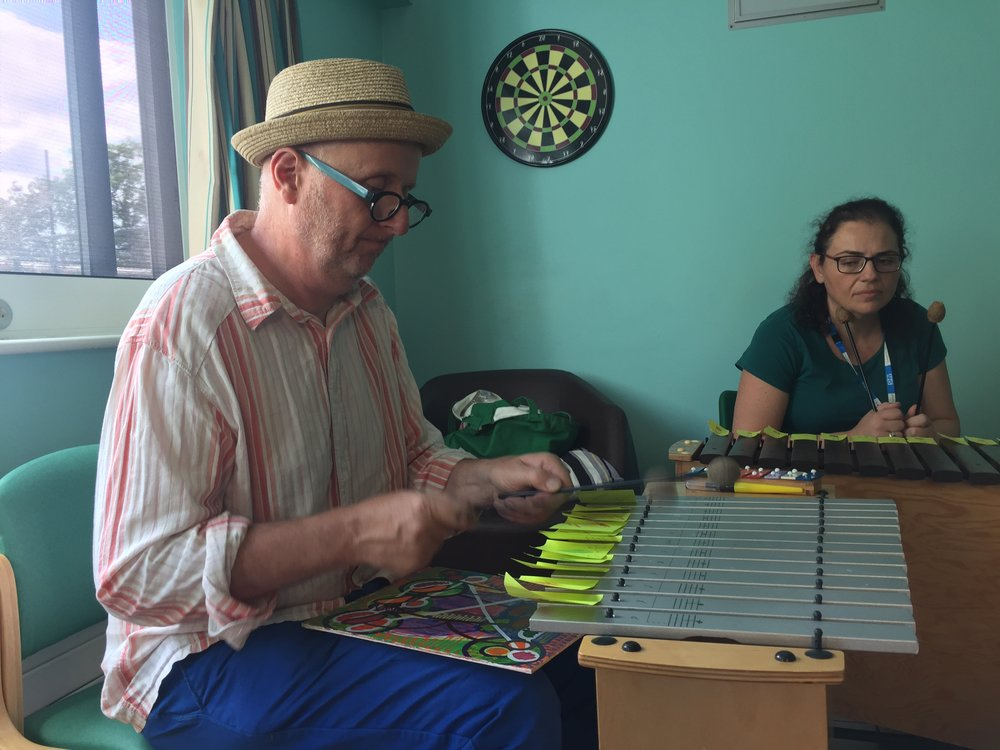 Bob and Roberta Smith in the music and art workshop he led for residents at Bluebell Lodge. We are grateful to musical therapist Pavlina Papadopolou who helped make the workshop possible and also took part.