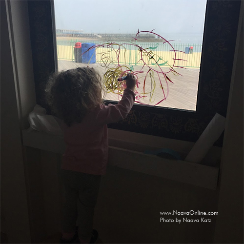 Drawing on the windows with washable markers (at the Westchester Children's Museum)