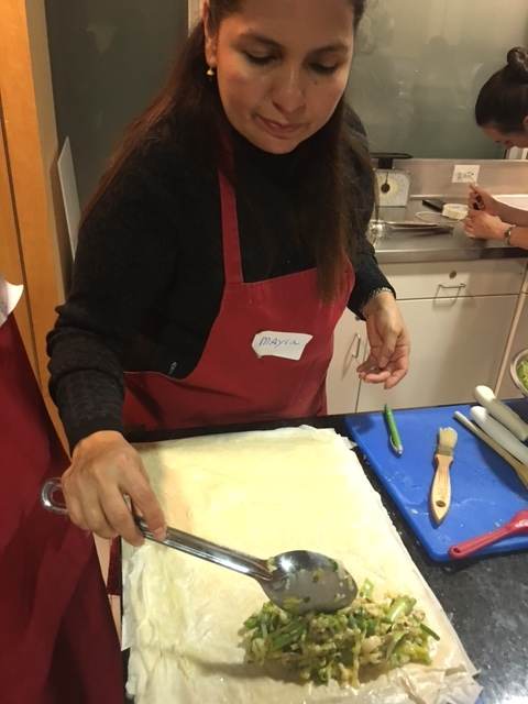 Class participant putting the finishing touches on the Asparagus, Gruyere and Mint Strudel.  Yum!