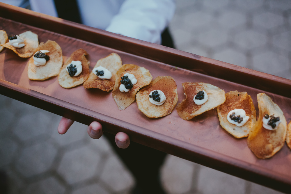 potato chips with caviar and creme fraiche.JPG