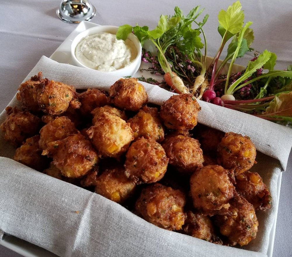 - Corn and crab hush puppies with pickled green tomato tartar sauce