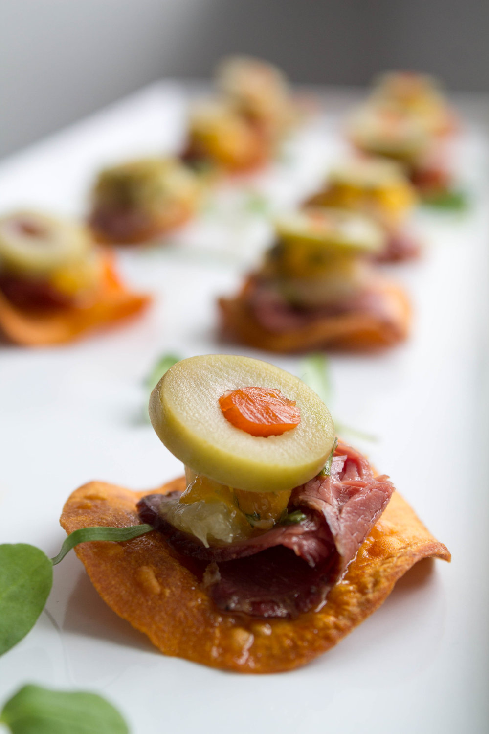 - Smoked duck, citrus-olive relish on a sweet potato chip
