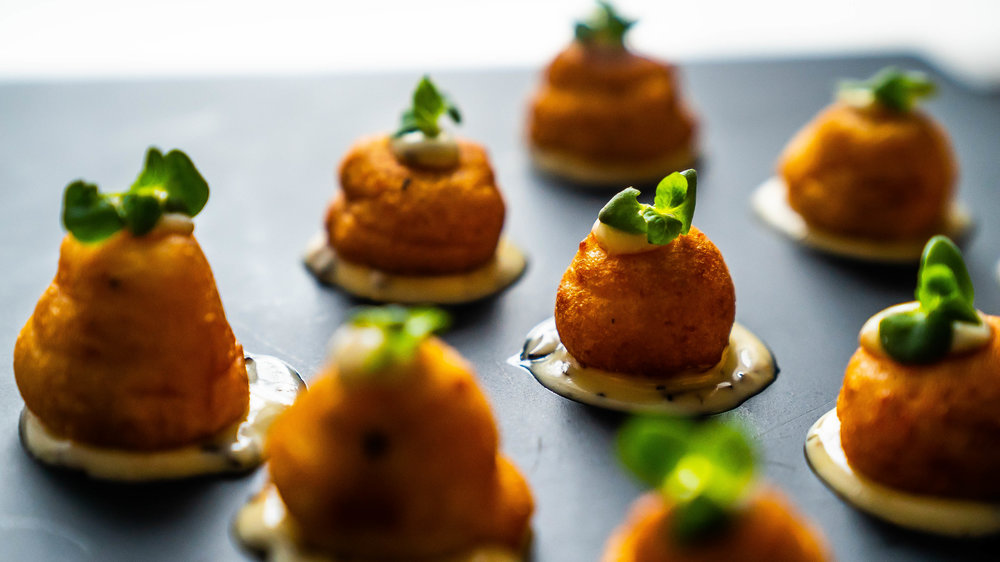 - Puffed potatoes with black truffle mayonnaise