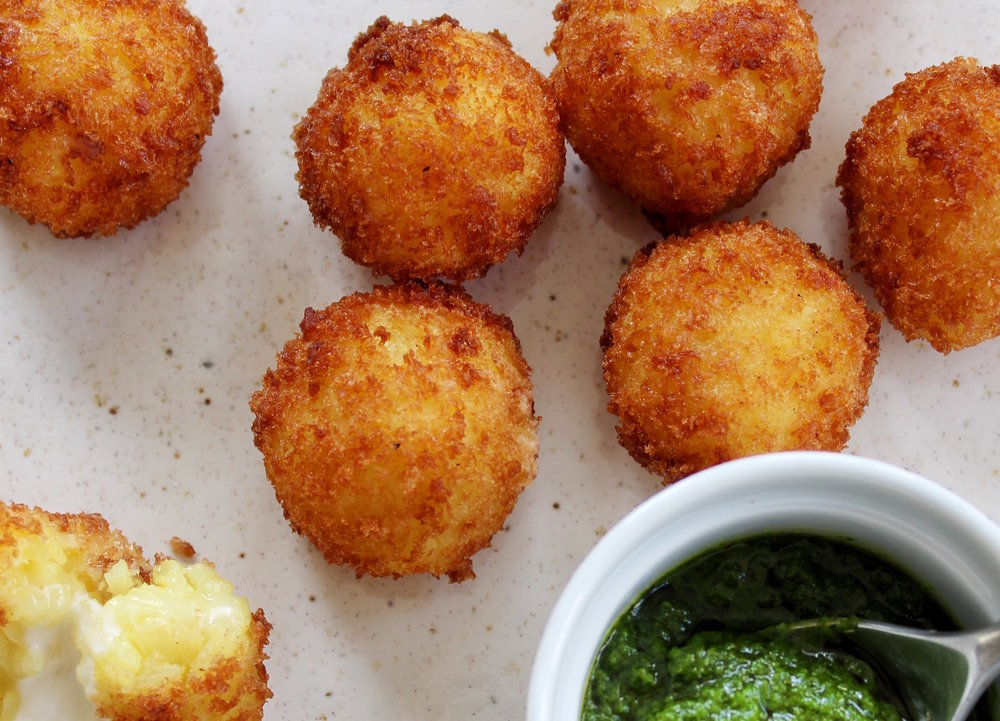 - Saffron arancini with basil pesto