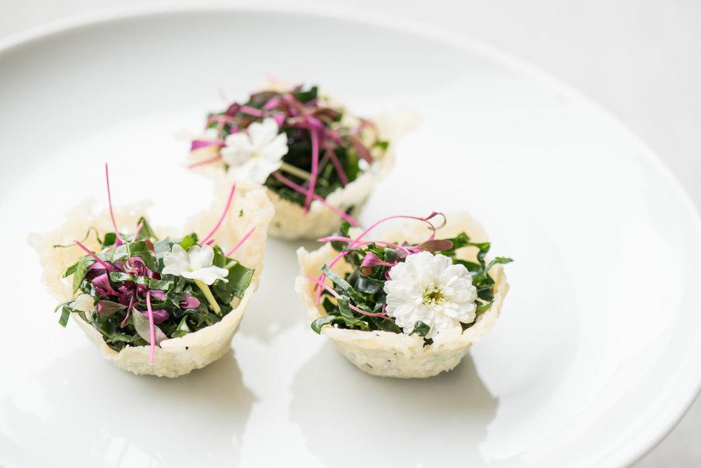 - Kale Caesar salad in a parmesan cup