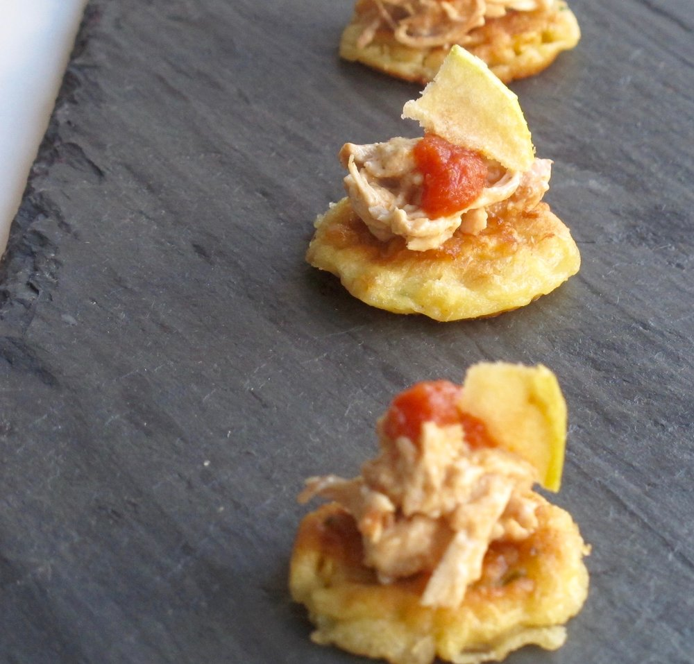 "- Smoked chicken on corn cake with tomato ""jam"" and braeburn apple chip"