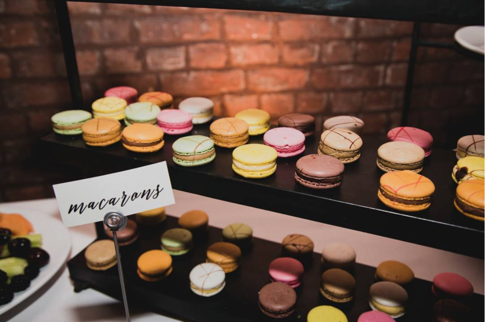 - French macarons in Summertime flavors—wild strawberry, blueberry, dark chocolate, and vanilla bean