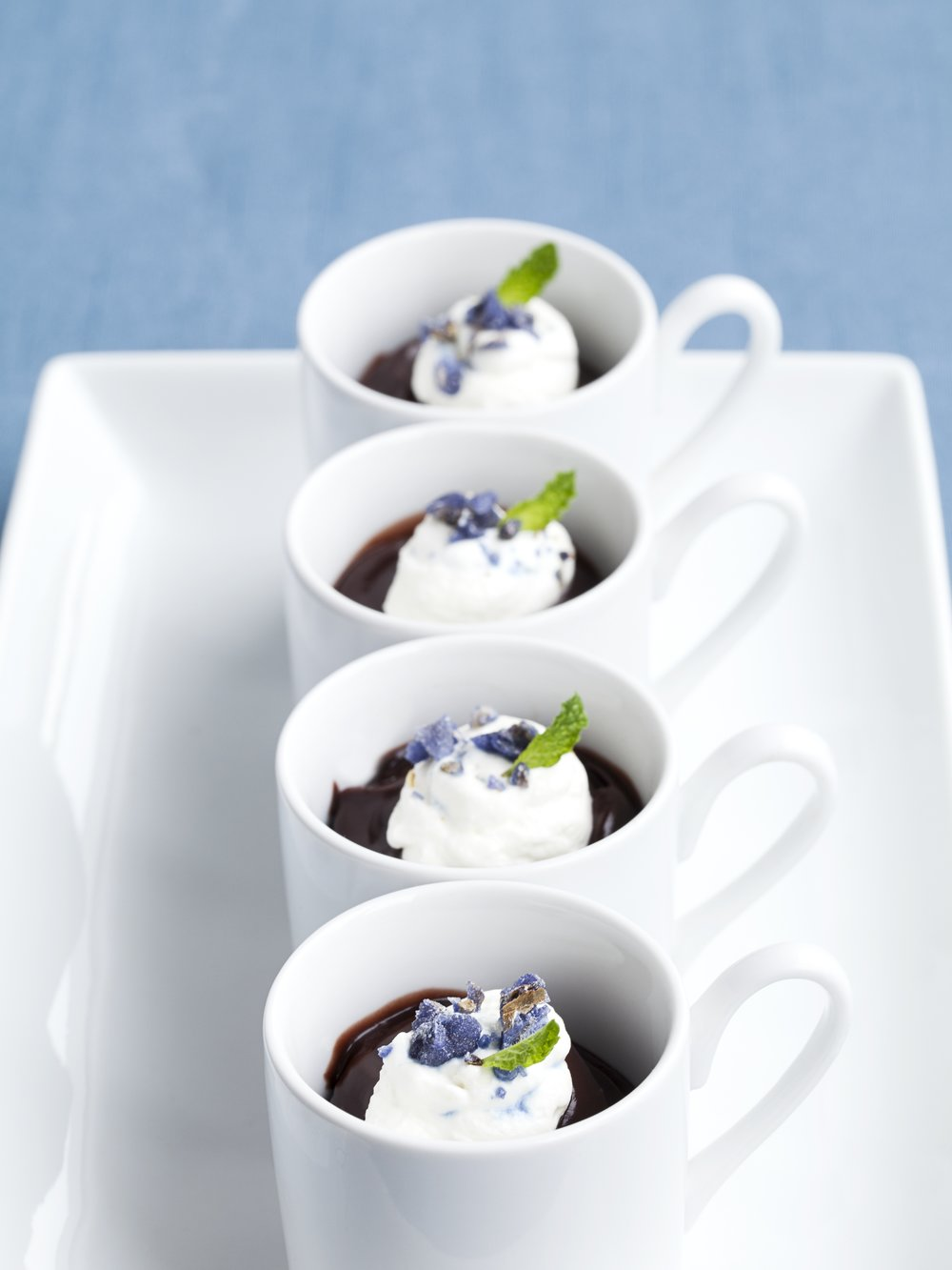 - Dark chocolate pudding with whipped crème fraiche and candied violets