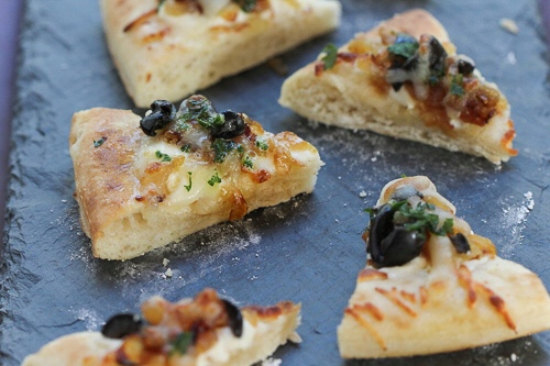 - Pizettes with Brooklyn ricotta caramelized onions, and salt cured olives