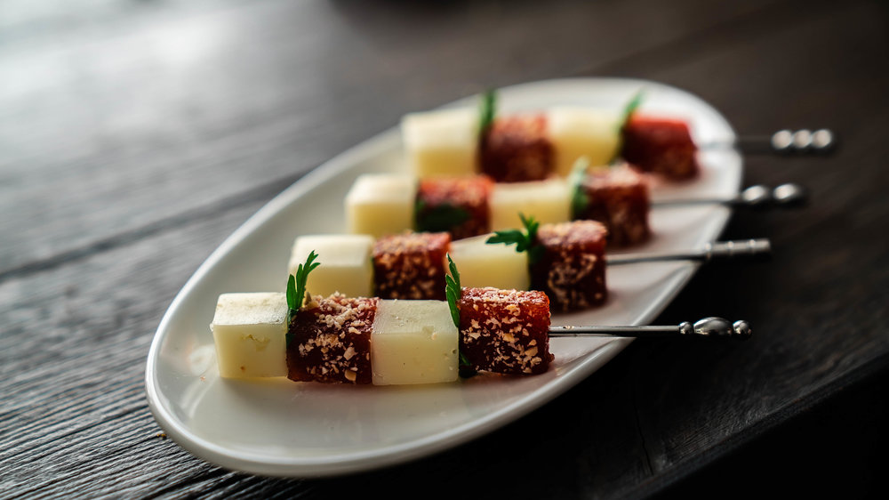 - Manchego, quince, and marcona almond skewers