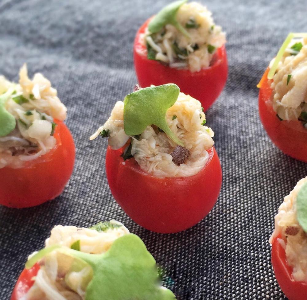- Heirloom cherry tomatoes stuffed with peekytoe crab
