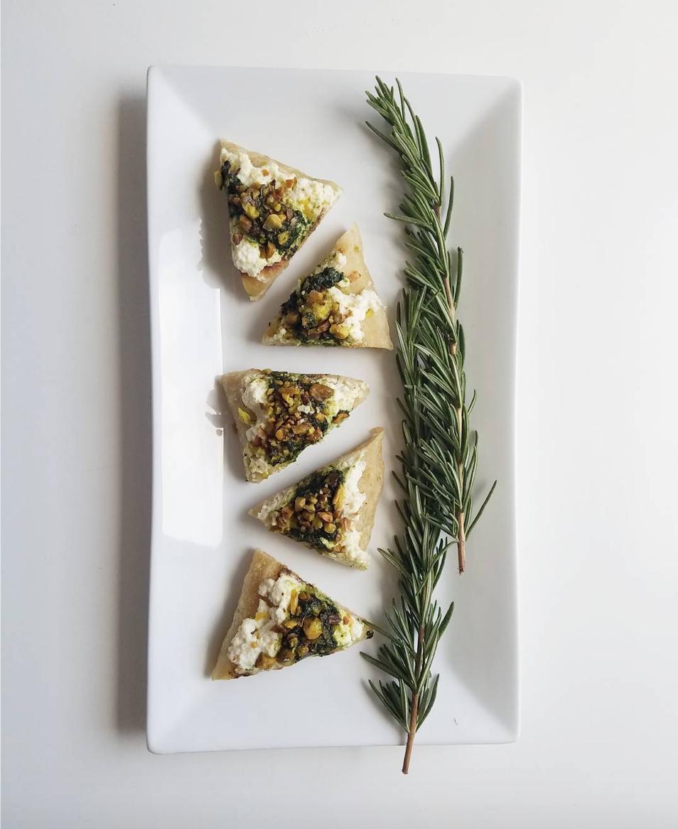 - Flatbread with basil, Salvatore Brooklyn smoked ricotta, and pistachio pesto