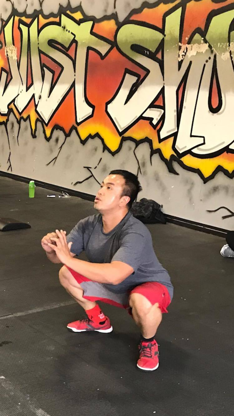 "Ging showing off a great air squat mid ""Murph"""