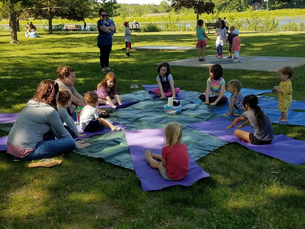 Thank you for another great season Cheryl! - Cheryl, the instructor with Let's Get Movin Yoga loves watching the growth and development of the children who tried yoga classes this year. She said It's the perfect setting for families to experience yoga for the first time and it's nice to see the older children helping the tots.They learn to sit quietly and be mindful of the breath and body which is a benefit of the class that the children are able to add into their daily lives.It warms her heart when watching children sit and breathe for a few minutes. The children learn to say their names loud and proud as well as experience the benefits of positive self-talk. She very much looks forward to sharing her classes again next season.