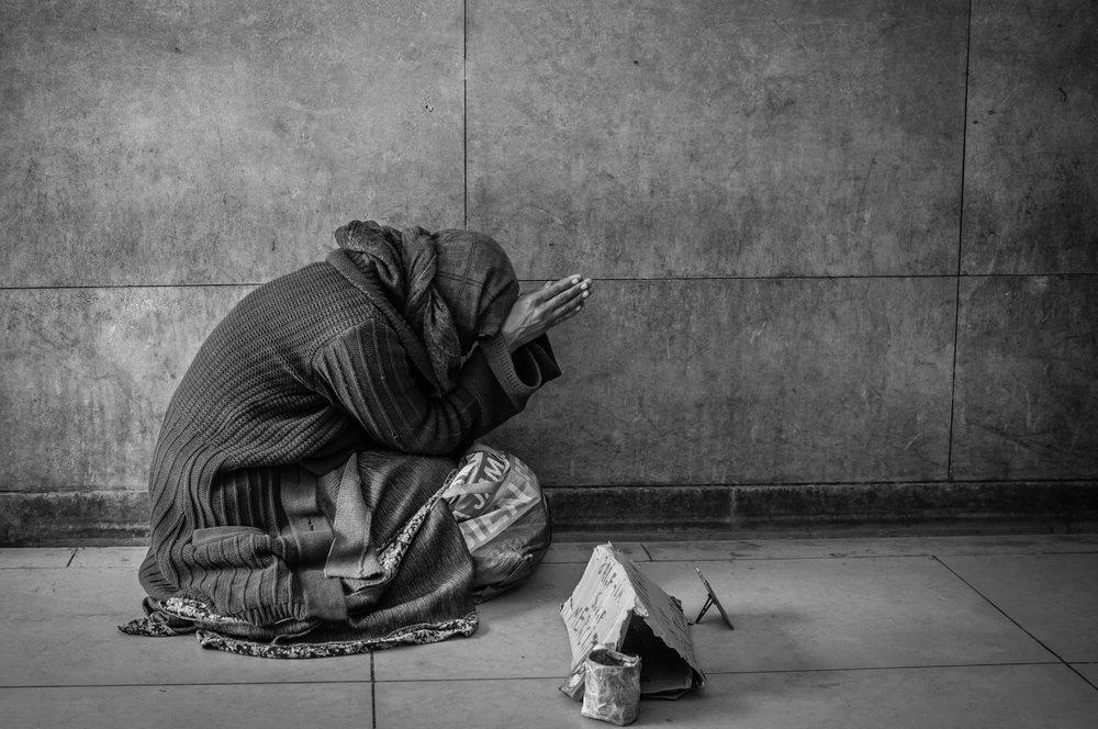 Beggar at the Arc