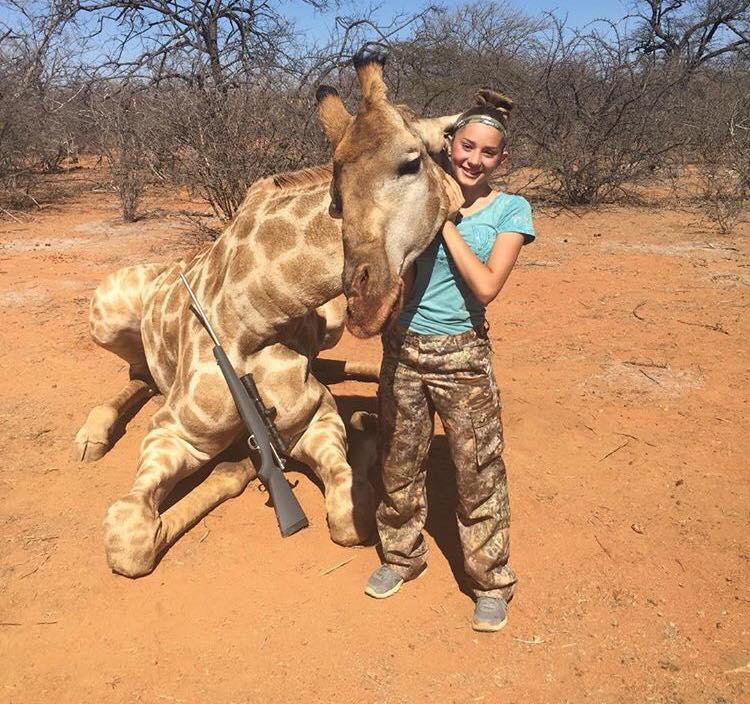 Aryanna Gourdin posing with dead giraffe Credit: Facebook