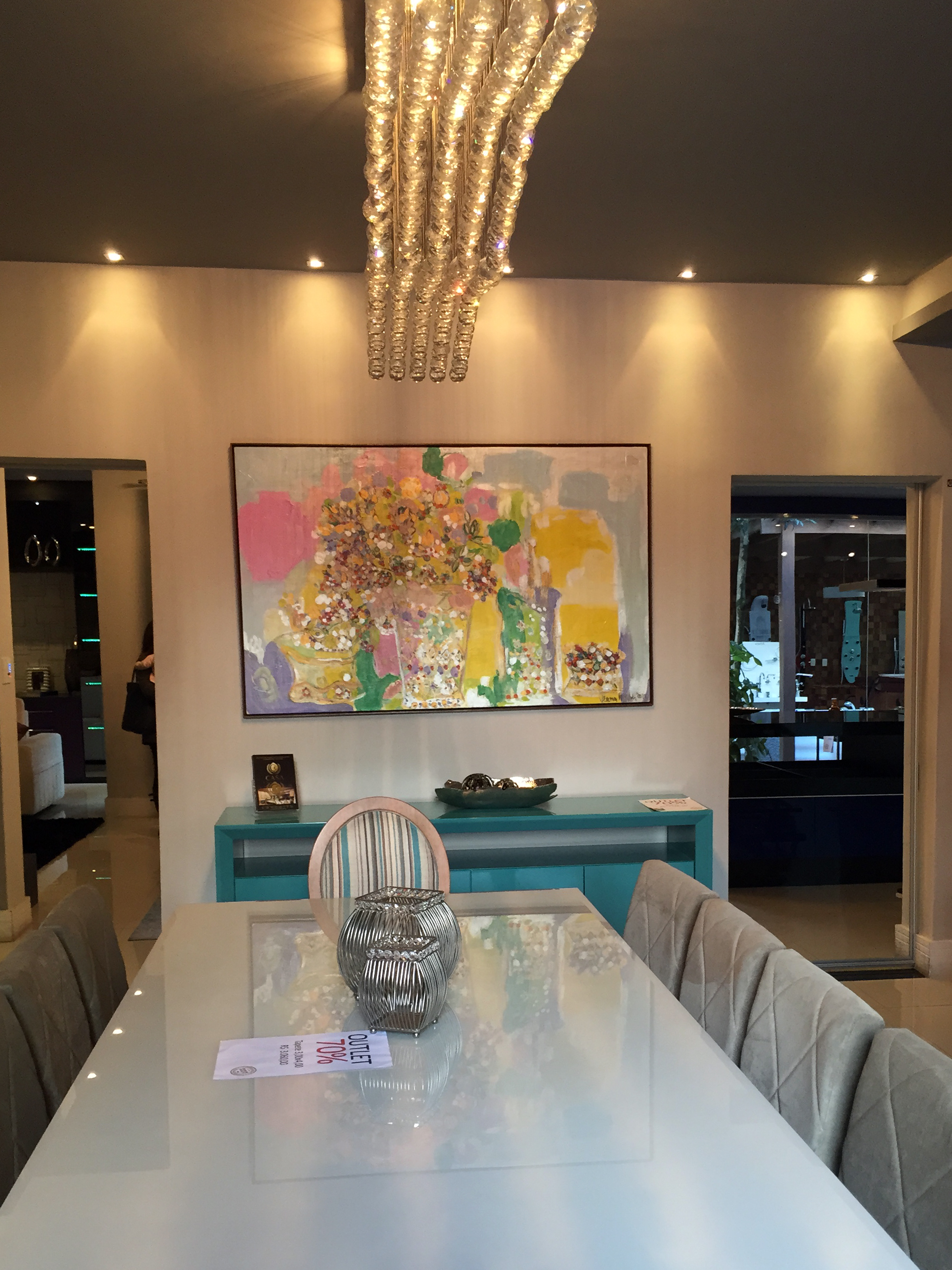 This dining room was to die for! Glossy bright furniture with also colourful wall art and a super chandelier (which can be made to fit by the way)