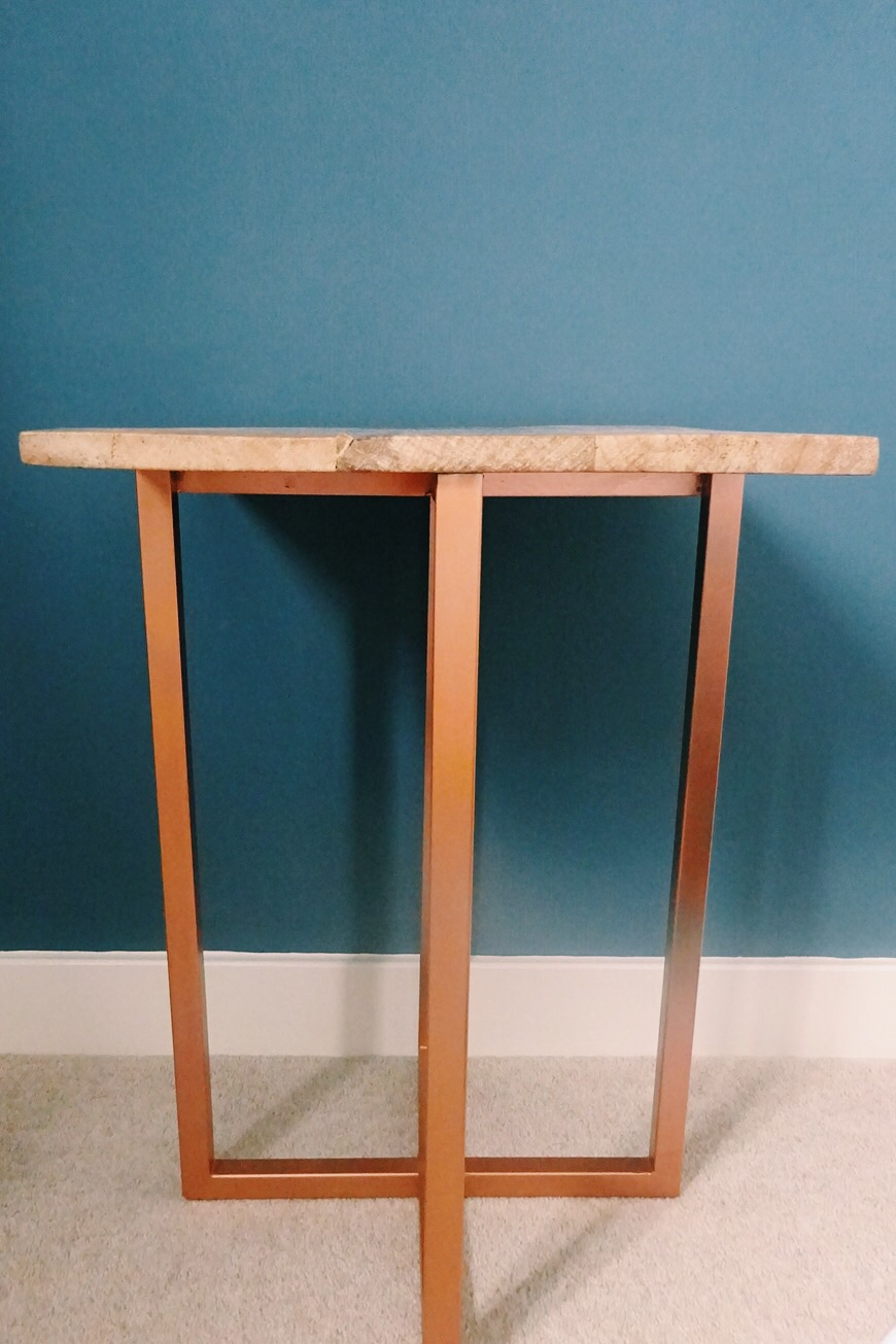 This used to be a silver legged bedside table, now an updated copper table after a couple of layers of spray paint.