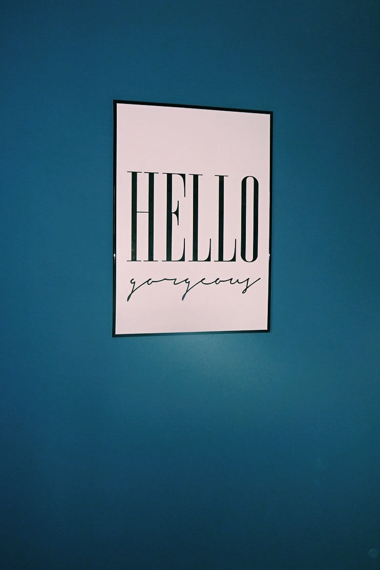 The typography poster fits in perfectly with the deep blue of the walls.