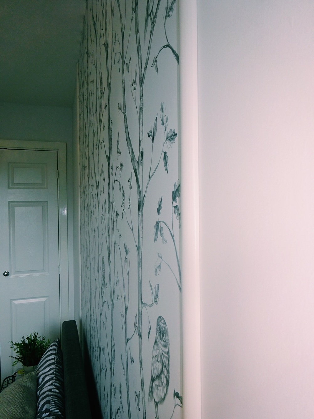Painted panel mouldings were the perfect finish for my headboard, and it was so easy to put them up!