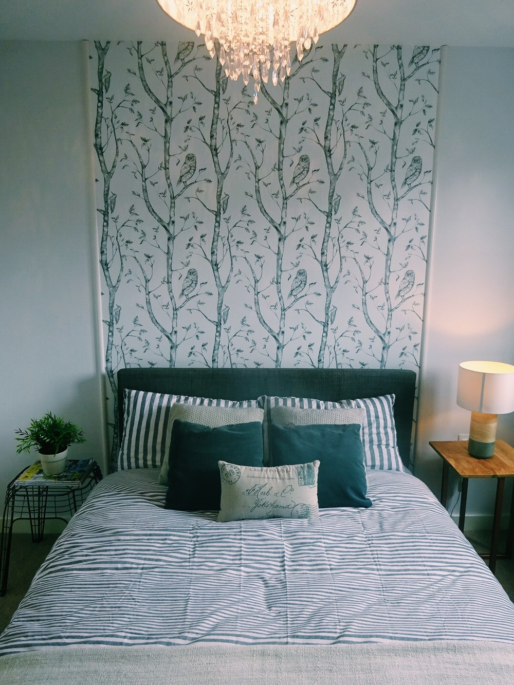 The    Gray  Woods WallPops wallpaper  Headboard finished, with the mismatching bed side tables. The metal one of from  Zara Home  and the other one was an old purchase from TK Maxx which I updated by spray painting the legs with copper spray paint.
