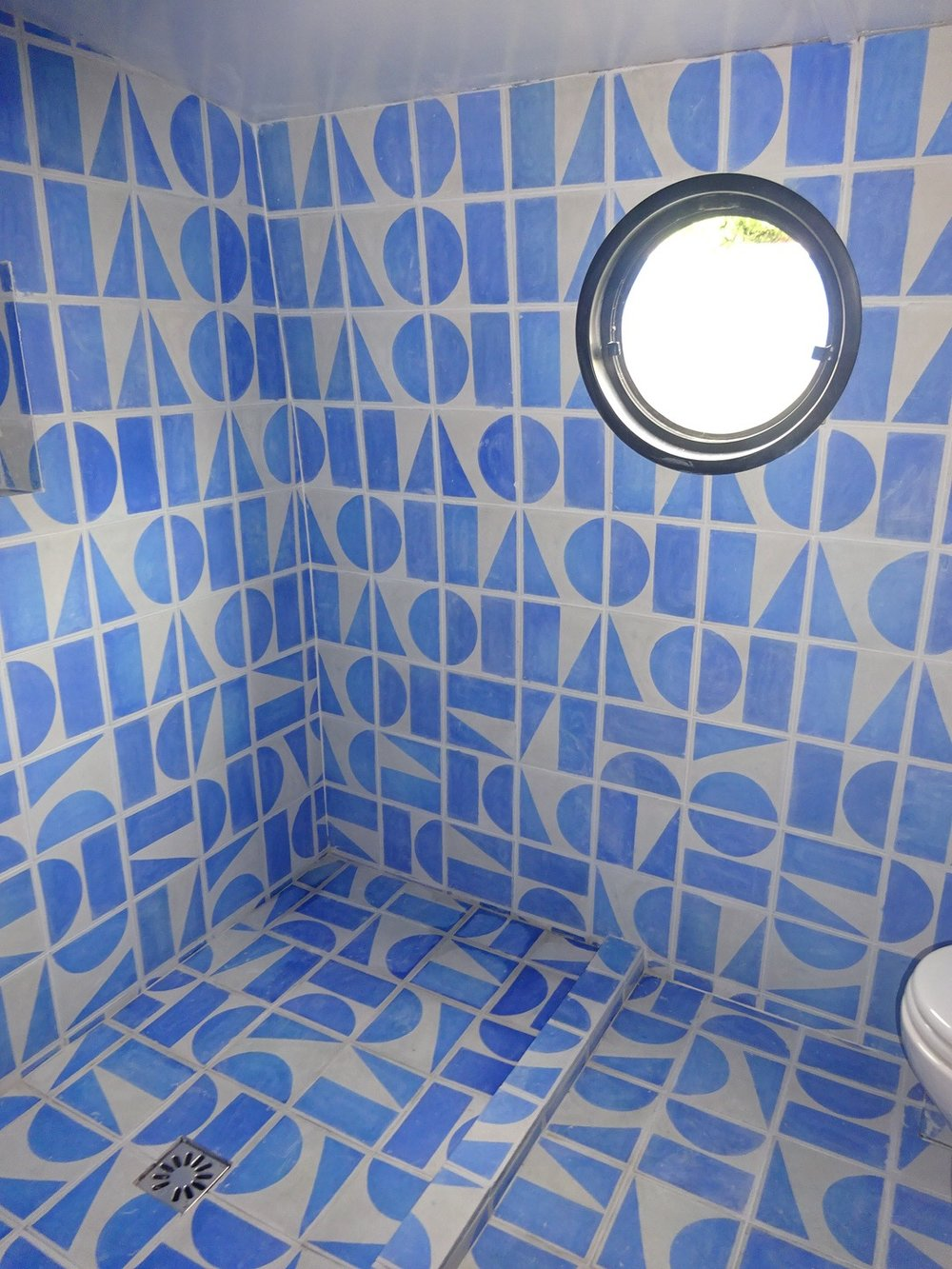 The blue Split Shift bathroom in the barge