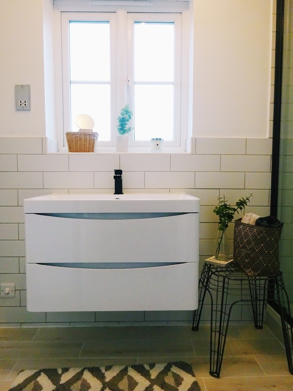 The wide sink is fantastic, and the storage underneath means I can hide all the bits and bobs that don't need to be seen. And even though the shower is much wider we still have enough space to fit the stool from Zara Home.