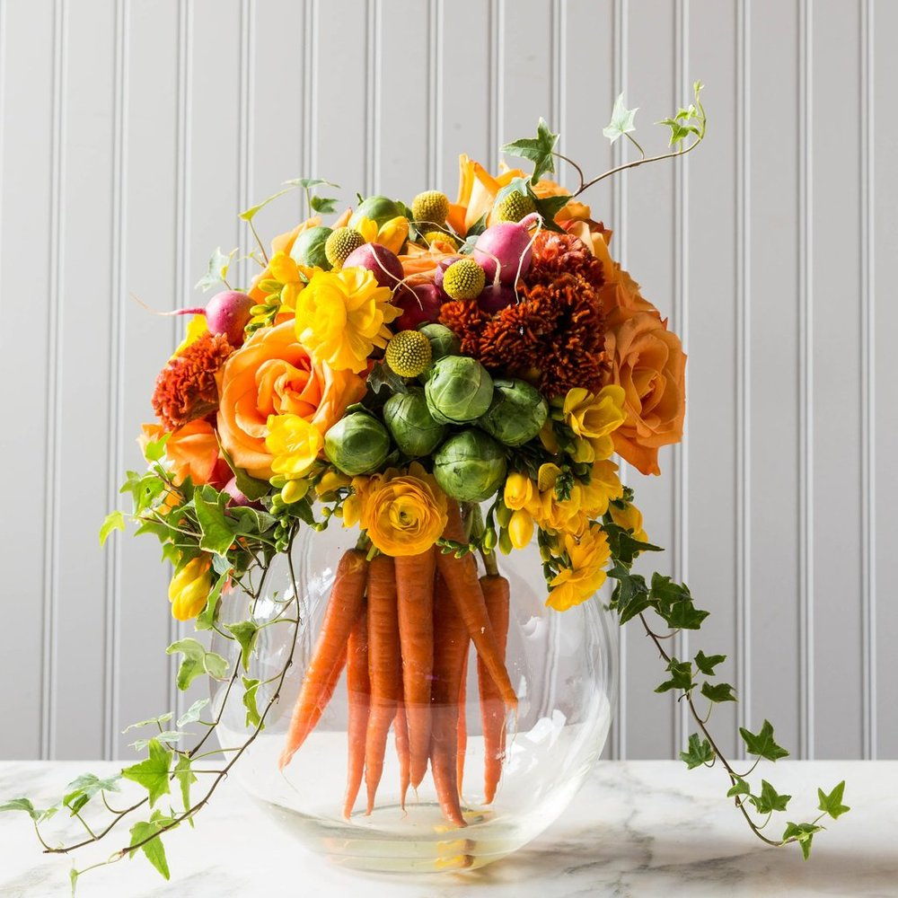 A stunning Easter centrepiece including fresh produce and flowers