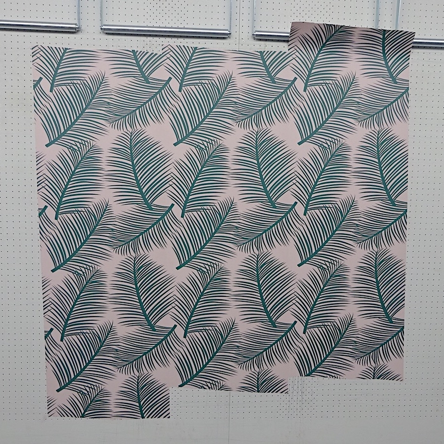 Once the colour match is done, the wallpaper is hung for final approval before printing