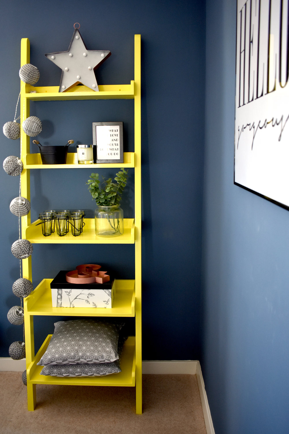 AFTER: The bookshelf was painted in Rust Oleum Bright Yellow