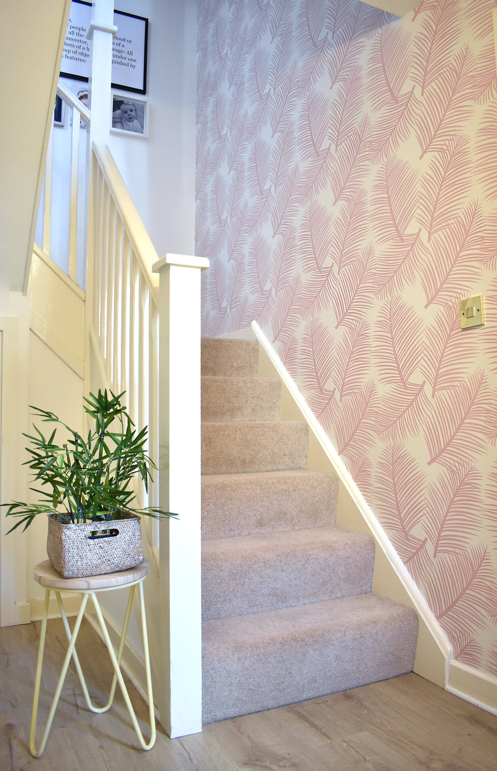 I love how the wallpaper flows through the wall, with its almost feather-like effect.  The Palm Leaf Garden Wallpaper in Blush  makes way for our family gallery wall.
