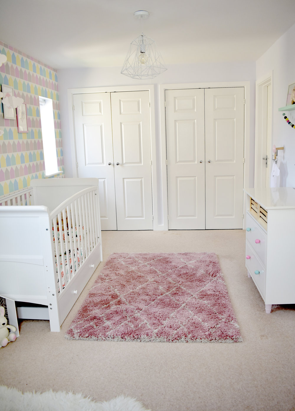 It is a long and narrow room so I have placed the furniture against the wall to allow for space for tummy time and play time on this soft Berber style rug.