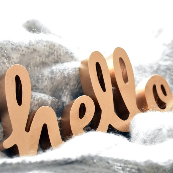 gold hello sign