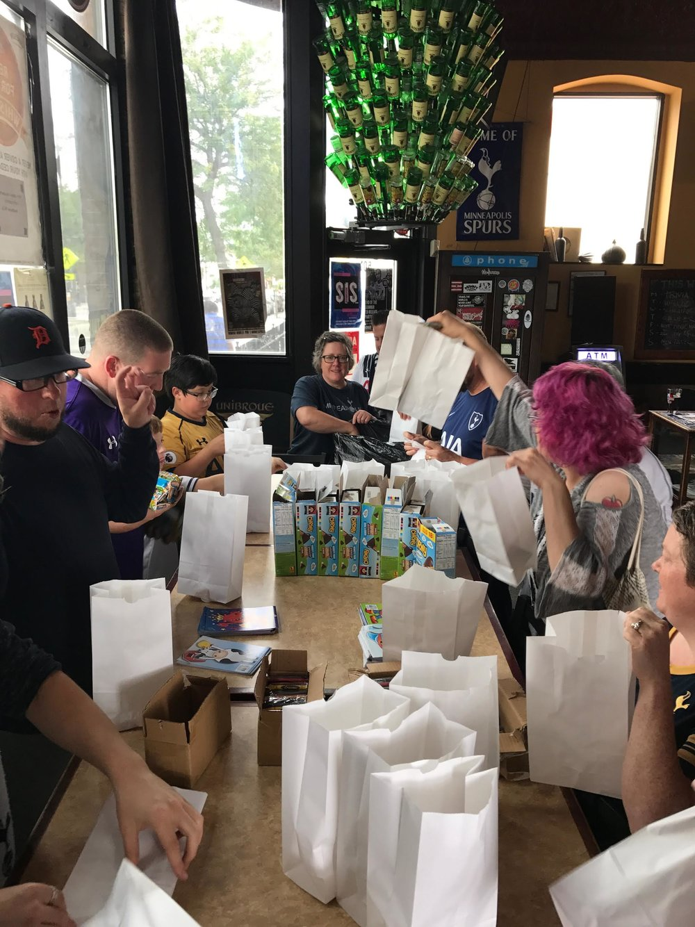 Club members preparing craft packs for the kids!